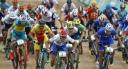 Cyclists, Marco Aurelio Fontana of Italy (7), Victor Koretzky of France (5), Daniel McConnell of Austria (11) and Nino Schurter of Switzerland (3) lead at the start of the men's cross-country cycling mountain bike race at the 2016 Summer Olympics in Rio de Janeiro, Brazil, Saturday, Aug. 20, 2016. (AP Photo/Patrick Semansky)